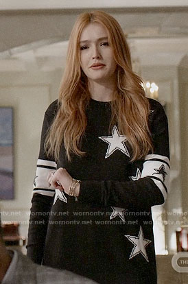 Kirby's black star print sweater on Dynasty