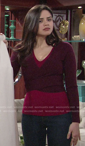 Lola's purple and pink layered sweater on The Young and the Restless