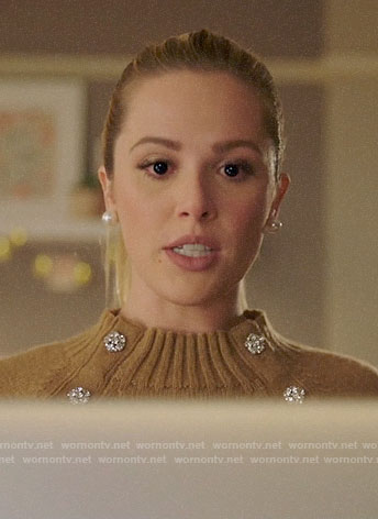 Lucy's tan sweater with jewel buttons on Charmed