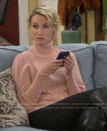 Mandy's pink puff sleeve sweater with pearl buttons on Last Man Standing