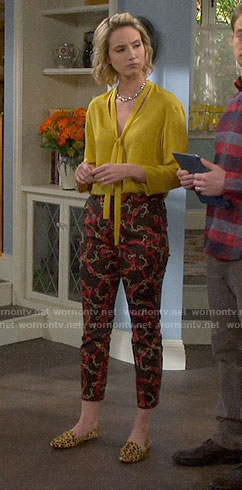 Mandy's yellow blouse and chain print pants on Last Man Standing