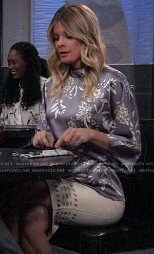 Nina's blue-grey floral blouse and white cutout skirt on General Hospital