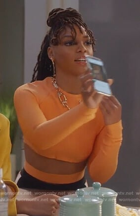 Jazlyn's orange crop top with waist cutout on Grown-ish