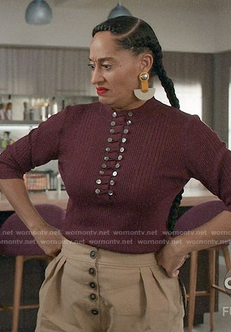 Bo's burgundy buttoned top and yellow statement earrings on Black-ish