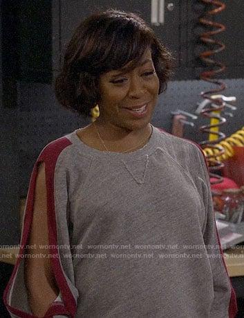 Tina's grey slit-sleeve sweatshirt on The Neighborhood