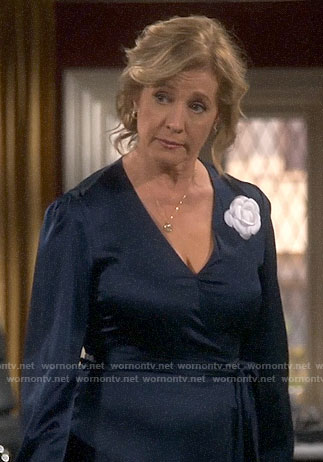 Vanessa's navy midi wrap dress on Last Man Standing