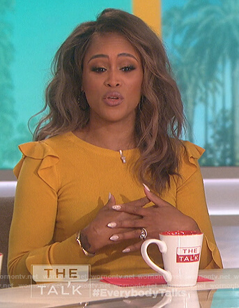 Eve's yellow ruffle shoulder sweater on The Talk