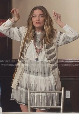 Alexis white embellished vest and embroidered dress on Schitt's Creek