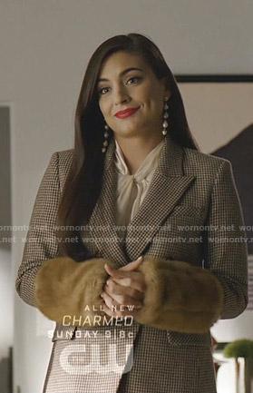 Cristal's houndstooth blazer with fur cuffs on Dynasty