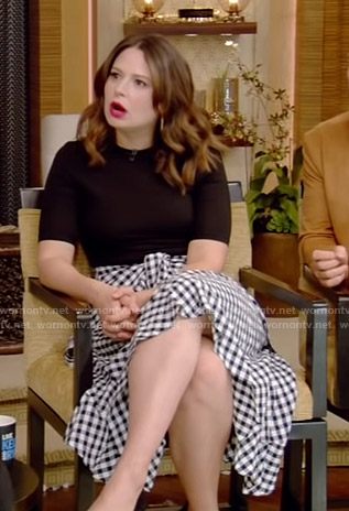 Katie Lowes's black top and gingham check skirt on Live with Kelly and Ryan