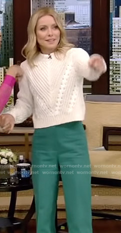 Kelly's white cropped sweater and green pants on Live with Kelly and Ryan
