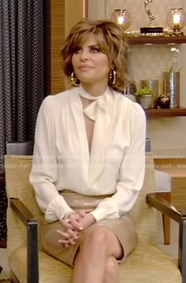 Lisa's white tie neck blouse and vinyl skirt on Live with Kelly and Ryan