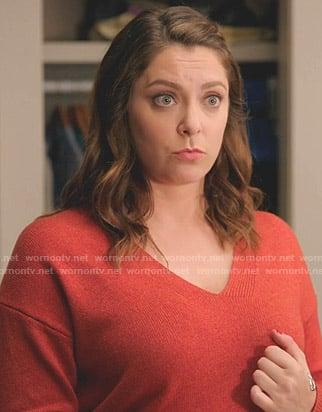 Rebecca's red v-neck sweater on Crazy Ex-Girlfriend