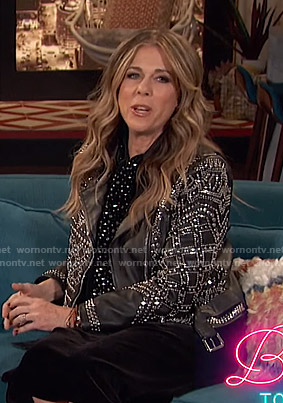Rita Wilson's black studded moto jacket on Busy Tonight