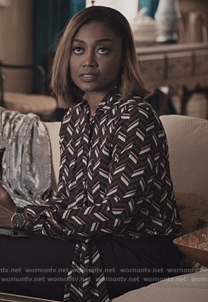 Daisy's black geometric print tie neck blouse on Madam Secretary
