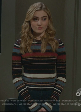 Taylor's black metallic striped sweater on American Housewife