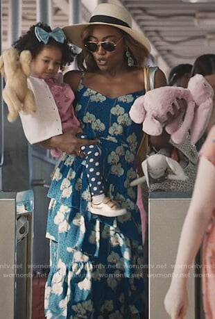 Daisy's blue floral ruffled dress on Madam Secretary