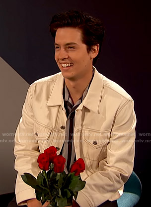 Cole Sprouse's white denim jacket on Busy Tonight