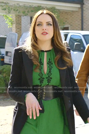 Fallon's green cutout dress and black coat on Dynasty