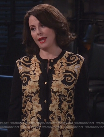 Karen's black floral print cardigan on Will and Grace