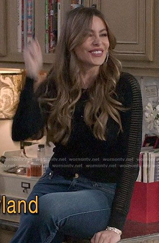 Gloria's black sheer ribbed panel cardigan on Modern Family