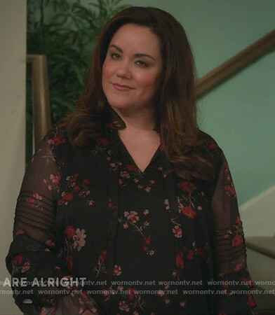Katie's black floral sheer blouse on American Housewife