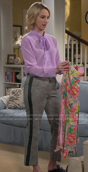 Mandy's purple tie neck blouse and side-stripe pants on Last Man Standing