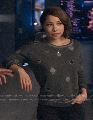 Nora's eclipse print sweatshirt on The Flash