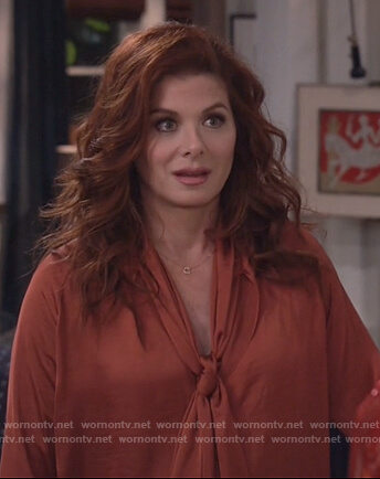Grace's metallic tie neck blouse on Will and Grace