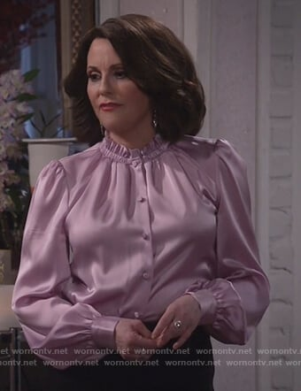 Karen's pink satin blouse and black skirt on Will and Grace