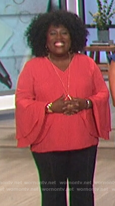 Sheryl's pink tiered bell sleeve top on The Talk