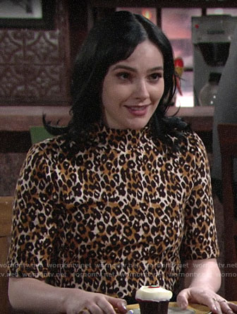 Tessa's leopard print top and black jeans on The Young and the Restless