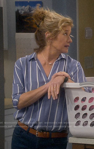 Vanessa's blue striped top and navy wedges on Last Man Standing
