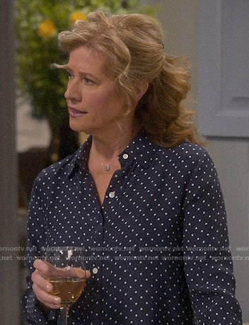 Vanessa's navy polka dot shirt on Last Man Standing