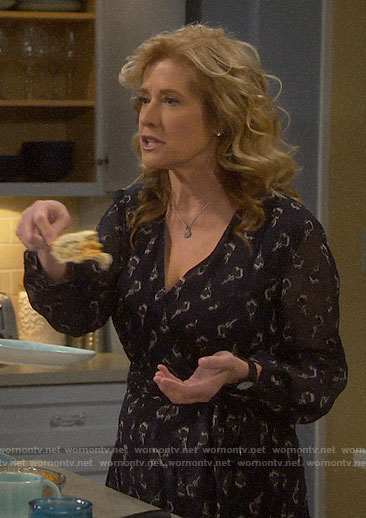 Vanessa's navy printed wrap dress on Last Man Standing