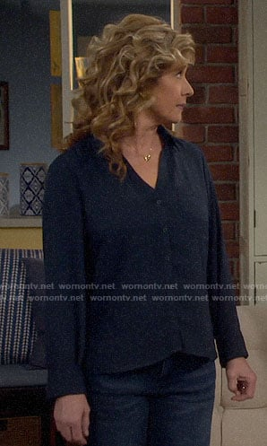Vanessa's navy button down shirt on Last Man Standing