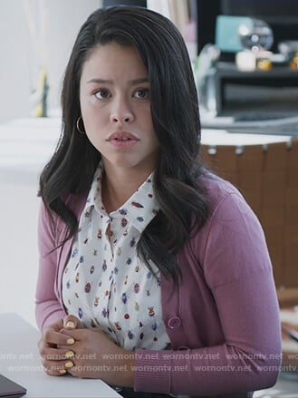 Mariana's white insect print blouse and pink cardigan on Good Trouble
