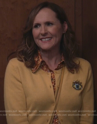 Val's yellow eye embroidered cardigan on Will and Grace