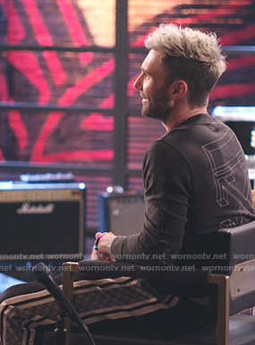 Adam Levine's black printed sweatshirt and Gucci pants on The Voice