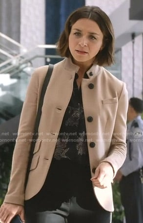 Amelia's black floral blouse and beige jacket on Grey's Anatomy