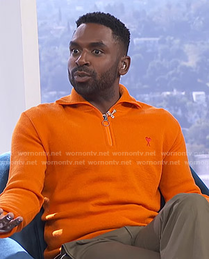 Justin's orange half-zip sweater on E! News Daily Pop