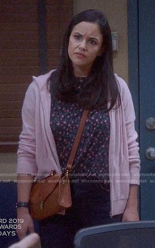 Amy's floral tee and pink hoodie on Brooklyn Nine-Nine