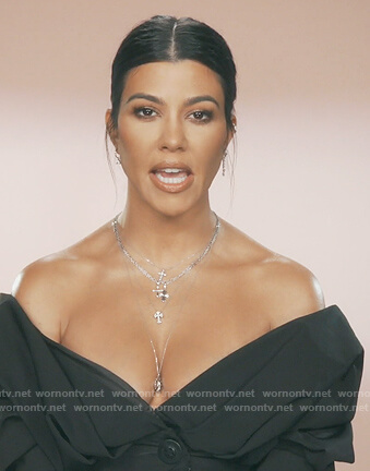 Kourtney's navy off shoulder shirt on Keeping Up with the Kardashians