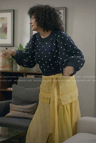 Bow's pom pom sweater and yellow striped skirt on Black-ish