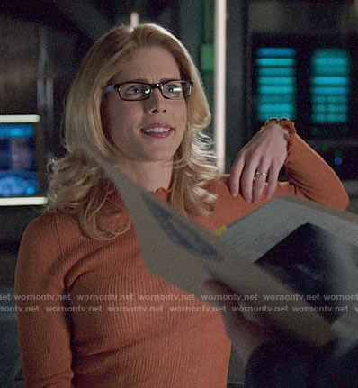 Felicity's orange ruffle trim top on Arrow