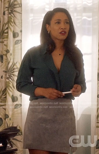 Iris's green blouse and grey suede skirt on The Flash
