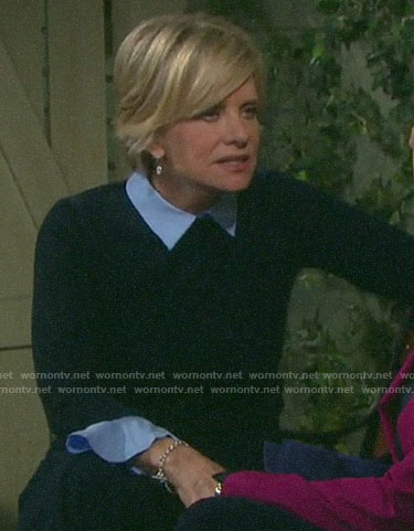 Kayla's navy sweater with ruffle cuffs on Days of our Lives