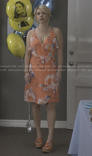 Lisa's orange floral wrap dress on Santa Clarita Diet