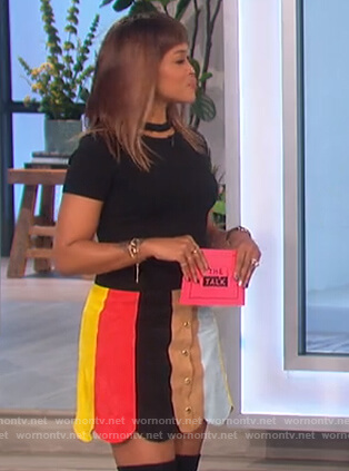 Eve's black cutout top and scalloped skirt on The Talk