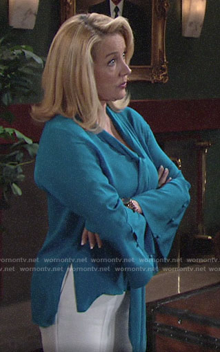 Nikki's blue bell-sleeve tie-neck blouse on The Young and the Restless